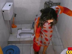 Bhabhi Sonia strips and shows her assets while ablution